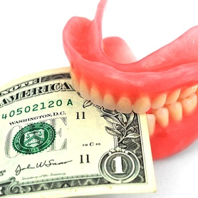 Cost of dentures in Crystal River demonstrated by dentures holding money