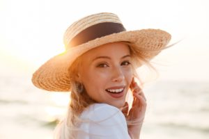 Woman enjoying summer after cosmetic dentistry